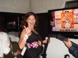 Playing Guitar Hero at E3